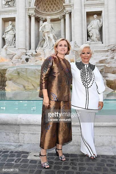 Silvia Venturini Fendi and Anna Fendi attend the Fendi Roma 90 Years Anniversary fashion show at Fontana di Trevi on July 7 2016 in Rome Italy