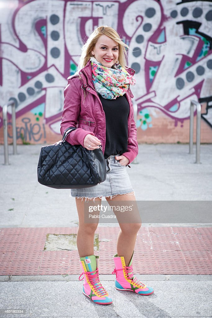 Silvia wears Bershka jacket, Zara handbag, Mango pullover and skirt and Munich boots on March 3, 2015 in Madrid, Spain.