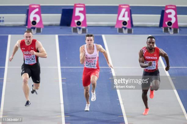 Silvian Wicki of Switzerland Markus Fuchs of Austria and Emre Zafer Barnes of Turkey compete in the qualification races of the men's 60m event on...