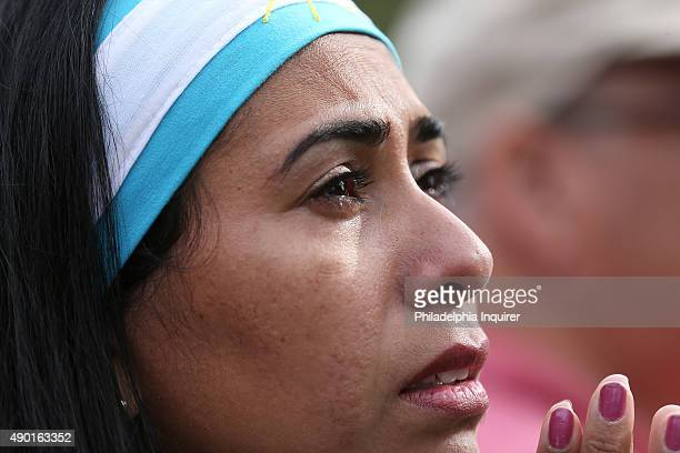 Silvina Rios of Philadelphia cries tears of joy as she watches the video monitor as Pope Francis arrives in Philadelphia on Saturday Sept 26 2015