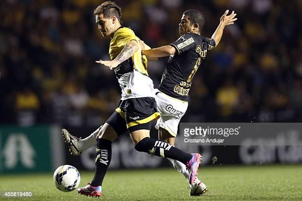 Silvinho of Criciuma fight for the ball with Junior Cesar of Botafogo during a match between Criciuma and Botafogo as part of Campeonato Brasileiro...