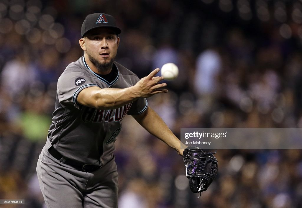 Silvino Bracho #61 of the Arizona Diamondbacks tosses the ball to first base in the eighth inning against the Colorado Rockies in a baseball game at Coors Field on September 2, 2016 in Denver, Colorado.