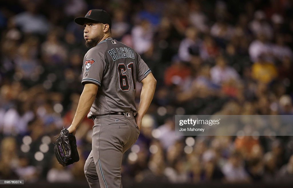 Silvino Bracho #61 of the Arizona Diamondbacks walks to the dugout in the eighth inning after giving up a grand slam home run to Nick Hundley #4 of the Colorado Rockies in a baseball game at Coors Field on September 2, 2016 in Denver, Colorado. The Rockies won 14-7.
