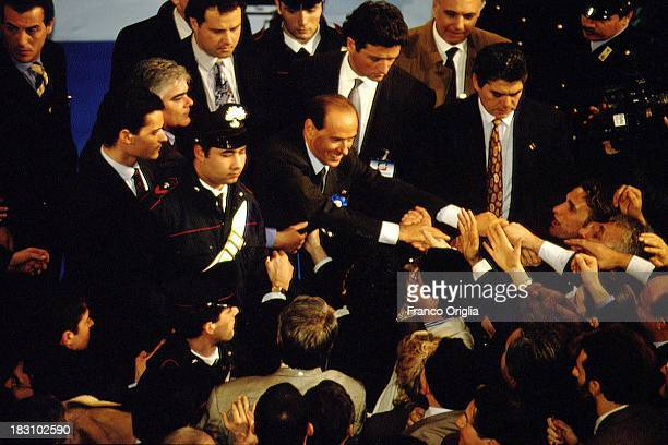 Silvio Berlusconi acknowledges the crowd during a rally for Forza Italia party at Palazzo Dei Congressi on February 6, 1994 in Rome, Italy.