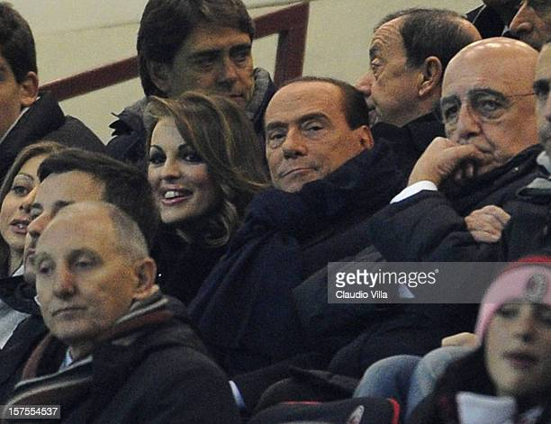 Silvio Berlusconi and Francesca Pascale attend the UEFA Champions League group C match between AC Milan and Zenit St Petersburg at San Siro Stadium...
