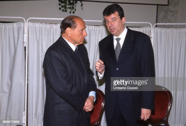 Silvio Berlusconi and Tarak Ben Ammar at the funeral chamber of the military hospital in Tunis when Bettino Craxi died in 2000