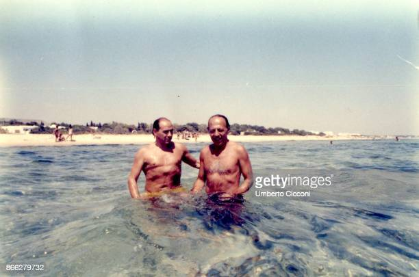 Silvio Berlusconi at the beach with Fedele Confalonieri in Hammamet in Tunisia in August 1984 There was even Bettino Craxi with them but he is not in...