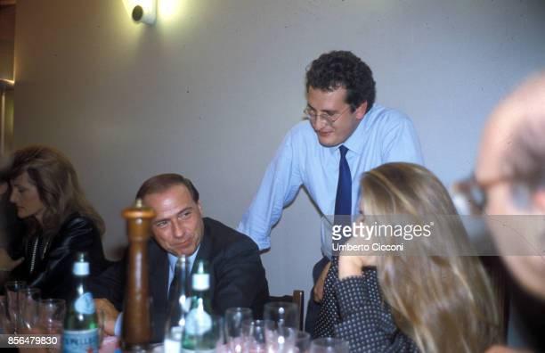 Silvio Berlusconi Bobo Craxi Veronica Lario and Maria Luisa Trussardi at a restaurant in Milan1 989