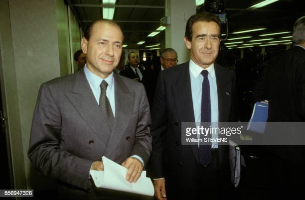 Silvio Berlusconi et JeanLuc Lagardere lors de l'audition au CSA pour l'attribution de la chaine de television 'La Cinq' le 22 octobre 1990 a Paris...