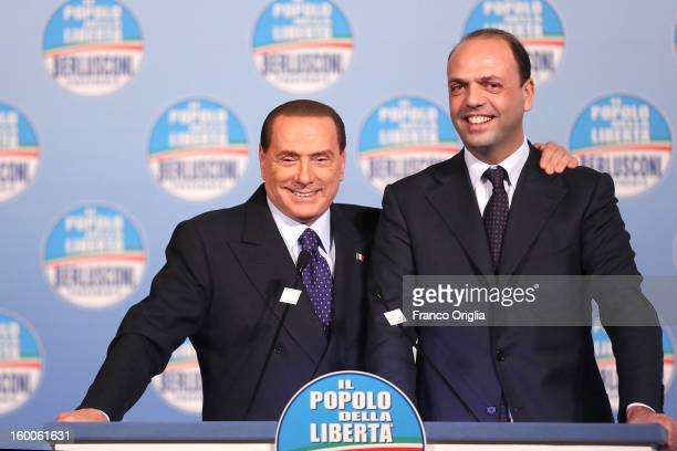 Silvio Berlusconi flanked by the secretary general of Popolo della Liberta party Angelino Alfano attends a meeting with candidates ahead of the...