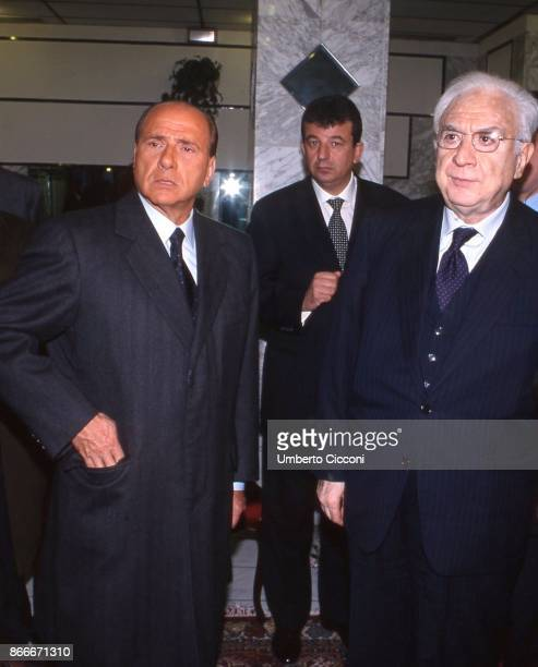 Silvio Berlusconi Francesco Cossiga and Tarak Ben Ammar at the funeral chamber of the military hospital in Tunis when Bettino Craxi died in 2000