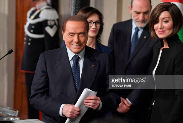 Silvio Berlusconi leader of the rightwing party 'Forza Italia' flanked by Anna Maria Bernini leaves after a meeting with Italian President Sergio...