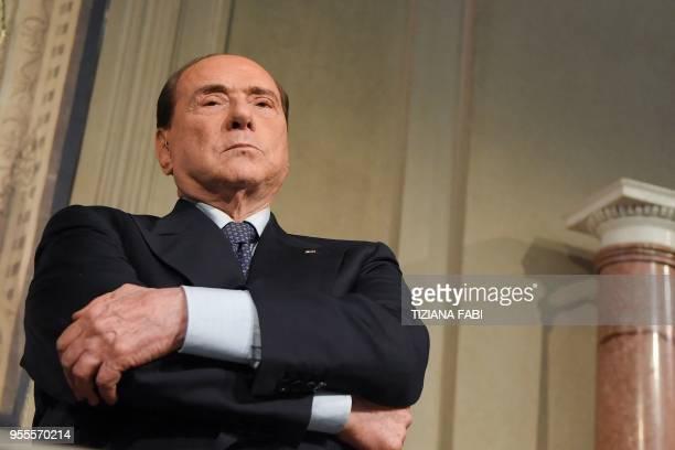 TOPSHOT Silvio Berlusconi leader of the rightwing party Forza Italia listens to Matteo Salvini leader of the farright party Lega speaking to the...