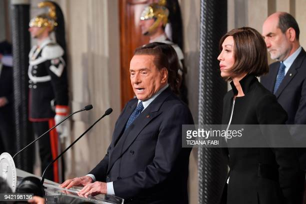 Silvio Berlusconi leader of the rightwing party 'Forza Italia' speaks to the press flanked by Anna Maria Bernini after a meeting with Italian...