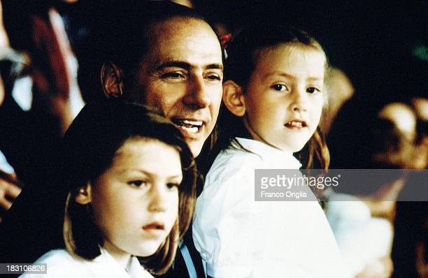 Silvio Berlusconi President of football team AC Milan and his daughters Eleonora and Barbara attend a match at the Giuseppe Meazza San Siro Stadium...