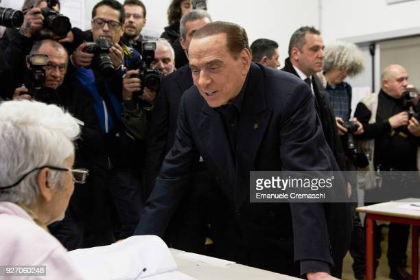 Silvio Berlusconi President of Forza Italia and former Italian Prime Minister holds his ballot before casting his vote at a polling station on March...