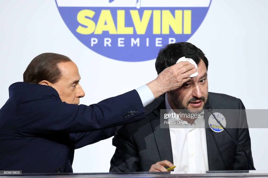 Silvio Berlusconi (L), president of 'Forza Italia' party, wipes the sweat to Matteo Salvini, leader of 'Lega' party during an electoral meeting of the centre-right coalition at the Adriano's Temple on March 1, 2018 in Rome, Italy. The Italian General Election takes place on March 4th 2018.