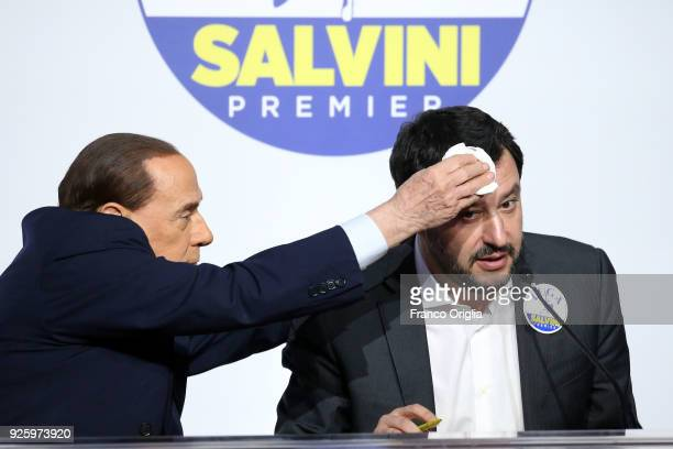 Silvio Berlusconi president of 'Forza Italia' party wipes the sweat to Matteo Salvini leader of 'Lega' party during an electoral meeting of the...