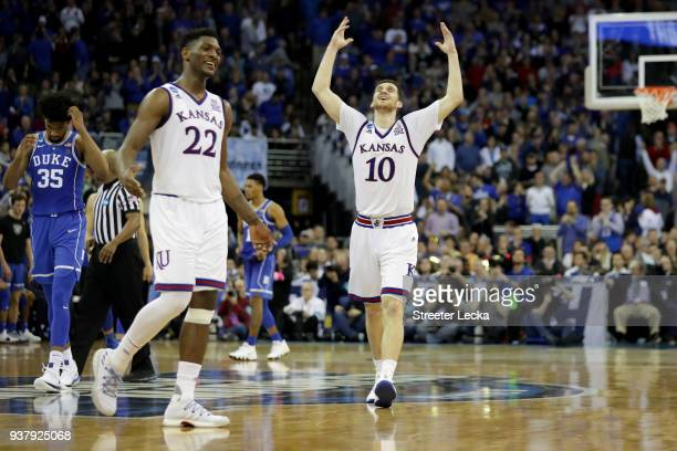 Silvio De Sousa and Sviatoslav Mykhailiuk of the Kansas Jayhawks celebrates after their team defeated the Duke Blue Devils in the 2018 NCAA Men's...