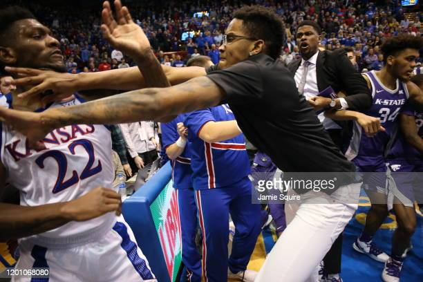 Silvio De Sousa of the Kansas Jayhawks and James Love III of the Kansas State Wildcats exchange blows during a brawl after the game at Allen...