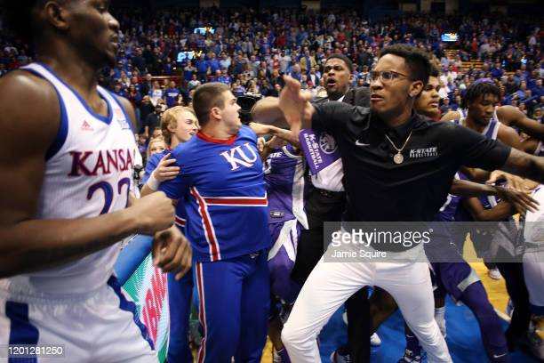 Silvio De Sousa of the Kansas Jayhawks and James Love III of the Kansas State Wildcats participate in a brawl after the game at Allen Fieldhouse on...