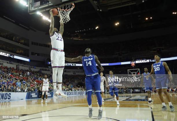 Silvio De Sousa of the Kansas Jayhawks dunks against Ismael Sanogo of the Seton Hall Pirates in the first half during the second round of the 2018...