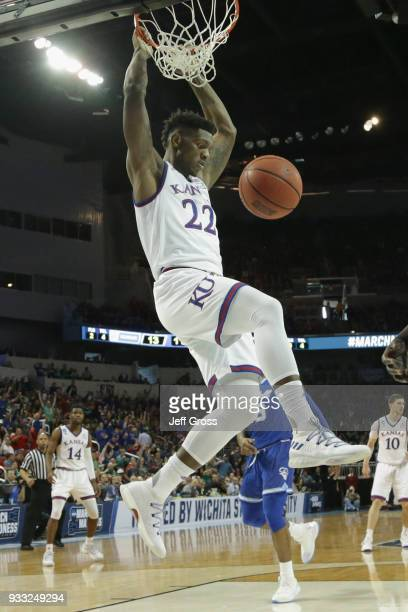Silvio De Sousa of the Kansas Jayhawks dunks against the Seton Hall Pirates in the first half during the second round of the 2018 NCAA Men's...