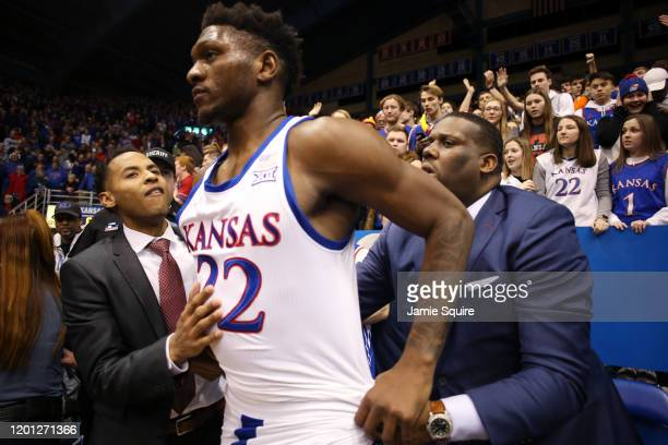 Silvio De Sousa of the Kansas Jayhawks is restrained by coaches during a brawl as the game against the Kansas State Wildcats ends at Allen Fieldhouse...