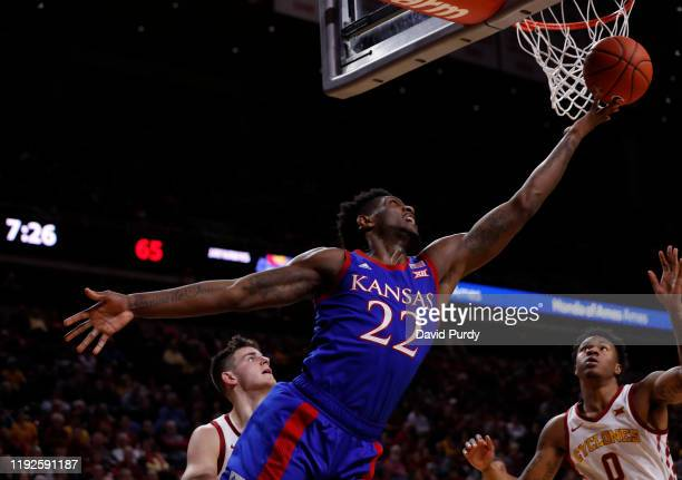 Silvio De Sousa of the Kansas Jayhawks lays up a shot as Michael Jacobson and Zion Griffin of the Iowa State Cyclones defend in the second half of...