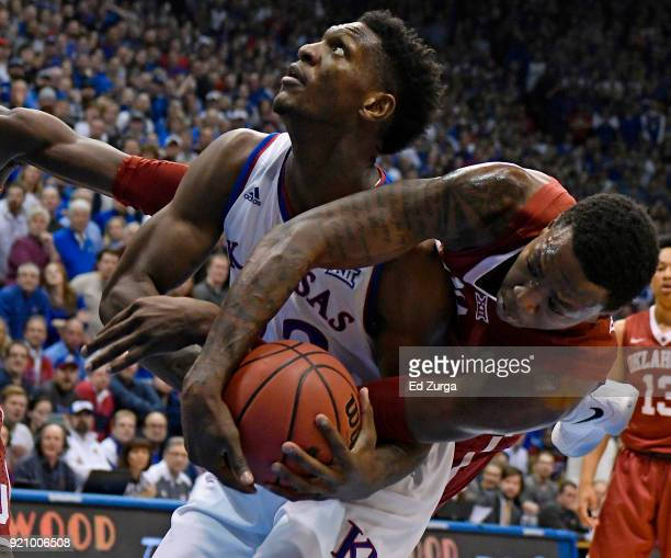 Silvio De Sousa of the Kansas Jayhawks looks to shoot as Kristian Doolittle of the Oklahoma Sooners tries to strip the ball away in the first half at...
