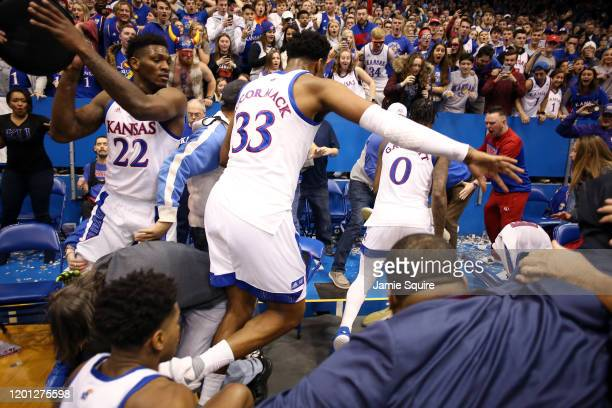 Silvio De Sousa of the Kansas Jayhawks picks up a chair during a brawl as the game against the Kansas State Wildcats ends at Allen Fieldhouse on...