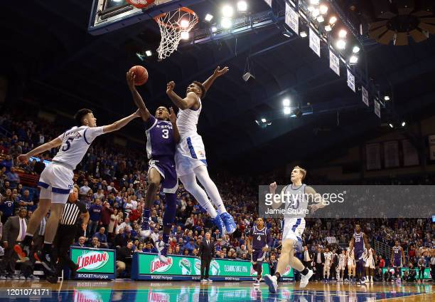 Silvio De Sousa of the Kansas Jayhawks swats the ball to block as DaJuan Gordon of the Kansas State Wildcats tries to score off a steal in the final...
