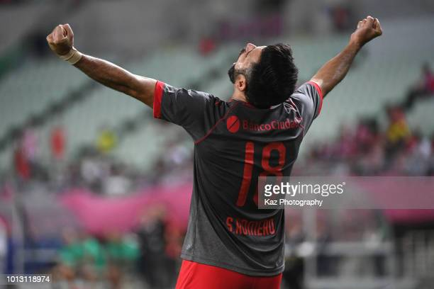 Silvio Ezequiel Romero of Independiente celebrates scoring the opening goal during the Suruga Bank Championship match between Cerezo Osaka and...