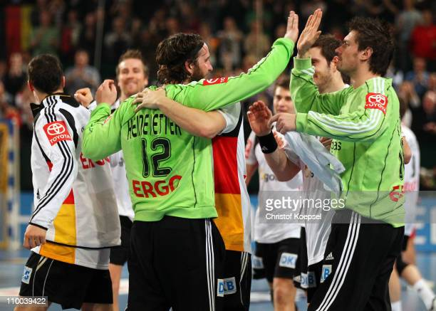 Silvio Heinevetter and Carsten Lichtlein of Germany celebrate after the Handball Euro Qualifier match between Germany and Iceland at Gerry Weber...