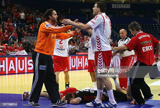 Silvio Heinevetter of Gemrany discusses with Michal Jurecki of Poland after the injury of Michael Haass of Germany and Krzysztof Lijewski of Poland...