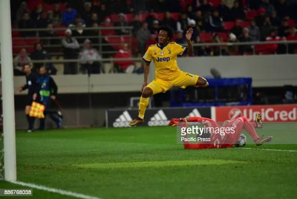 STADIUM ATHENS ATTIKI GREECE Silvio Proto goalkeeper of Olympiacos stops the effort of Juan Cuadrado of Juventus Juventus won 20