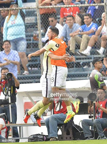 Silvio Romero and Bruno Valdez of America celebrate after scoring a goal against Cruz Azul during their Mexican Apertura 2016 tournament football...