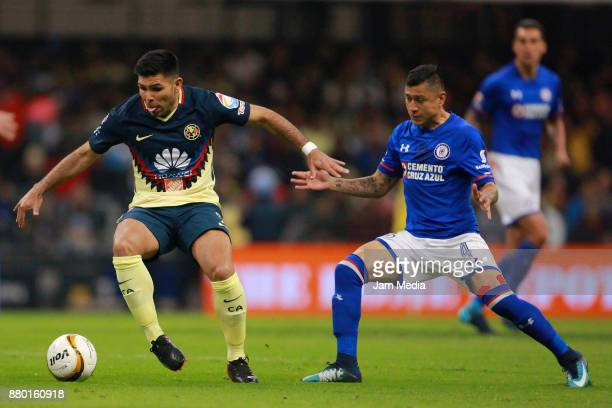 Silvio Romero of America and Julio Dominguez of Cruz Azul fight for the ball during the quarter finals second leg match between America and Cruz Azul...
