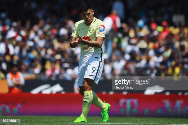 Silvio Romero of America celebrates after scoring the first goal of his team during the 11th round match between Pumas UNAM and America as part of...