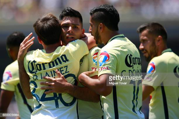 Silvio Romero of America celebrates after scoring the first goal of his team during the 11st round match between Pumas UNAM and America as par of the...
