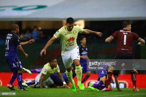 Silvio Romero of America celebrates after scoring the first goal of his team during the 14th round match between America and Queretaro as part of the...