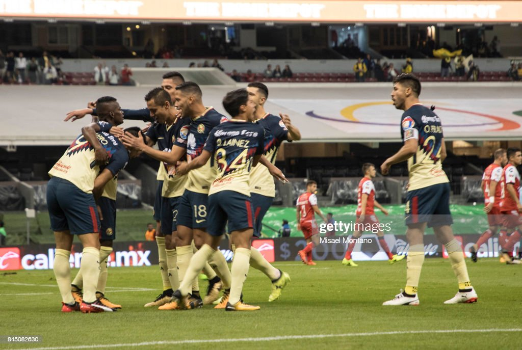 Silvio Romero of America celebrates with teammates after scoring the first goal of his team during the 8th round match between America and Veracruz as part of the Torneo Apertura 2017 Liga MX at Azteca Stadium on September 09, 2017 in Mexico City, Mexico.