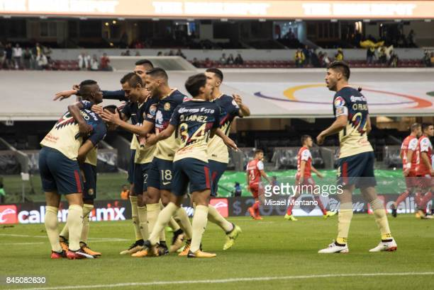 Silvio Romero of America celebrates with teammates after scoring the first goal of his team during the 8th round match between America and Veracruz...
