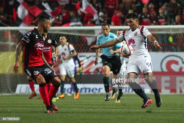 Silvio Romero of America competes for the ball with Victor Aguilera of Tijuana during the 9th round match between Tijuana and America as part of the...