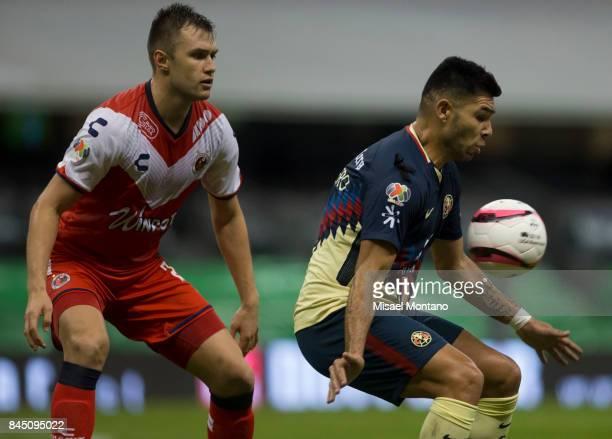 Silvio Romero of America controls the ball under the pressure of Kristian Alvarez of Veracruz during the 8th round match between America and Veracruz...