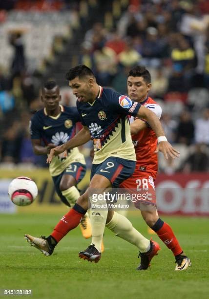 Silvio Romero of America fights for the ball with Jesus Peganoni of Veracruz during the 8th round match between America and Veracruz as part of the...