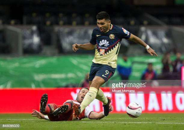 Silvio Romero of America fights for the ball with Jose Velazquez of Veracruz during the 8th round match between America and Veracruz as part of the...