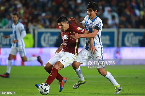 Silvio Romero of America struggles for the ball with Erick Gutierrez of Pachuca during the 17th round match between Pachuca and America as part of...