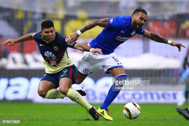 Silvio Romero of America struggles for the ball with Julian Velazquez of Cruz Azul during the quarter finals second leg match between America and...