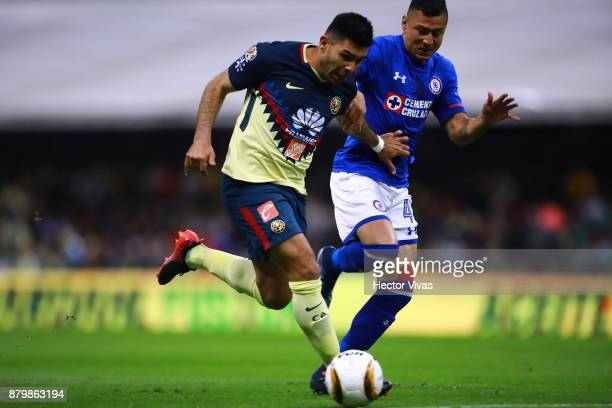 Silvio Romero of America struggles for the ball with Julio Cesar Dominguez of Cruz Azul during the quarter finals second leg match between America...